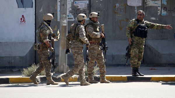 Полицейские возле места взрыва в Кабуле, Афганистан, 17 сентября - Sputnik Тоҷикистон