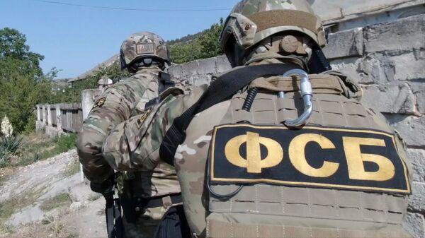 Задержание сотрудниками ФСБ РФ, архивное фото - Sputnik Тоҷикистон