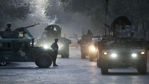 Афганские силовики на месте происшествия после вооруженного нападения на университет в Кабуле, Афганистан - Sputnik Таджикистан