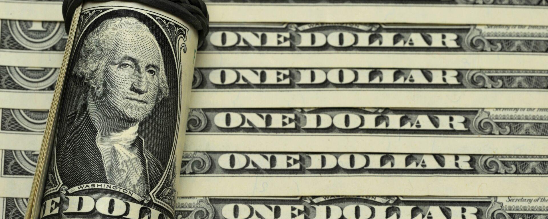 Банкноты номиналом 1 доллар США. - Sputnik Таджикистан, 1920, 23.09.2021