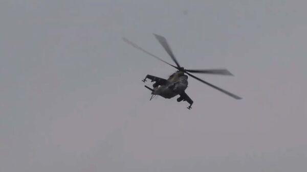 Первые в 2021-м: учения вертолетчиков российской базы в Таджикистане - YouTube - Sputnik Тоҷикистон