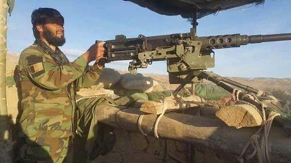 Сотрудник национальной обороны Афганистана на посту - Sputnik Тоҷикистон