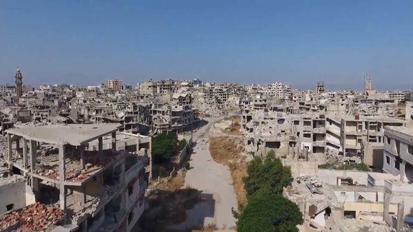 Беспилотник заснял разрушенный Хомс в десятую годовщину начала войны в Сирии - YouTube - Sputnik Тоҷикистон
