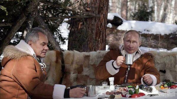 Таътили шадиди Сибирӣ: Президенти Русия ва вазири мудофиа ба тайга рафтанд - Sputnik Тоҷикистон