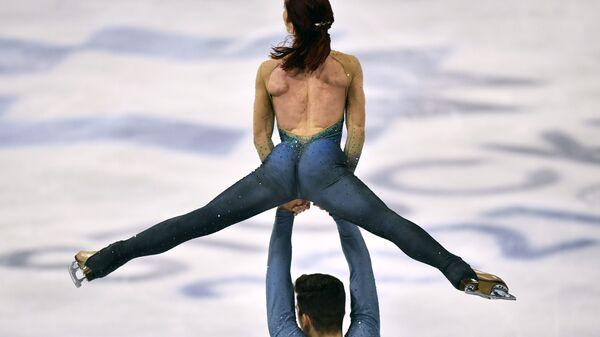 Итальянские фигуристы Николь Делла Моника и Маттео Гуарисе на чемпионате мира по фигурному катанию в Стокгольме - Sputnik Таджикистан
