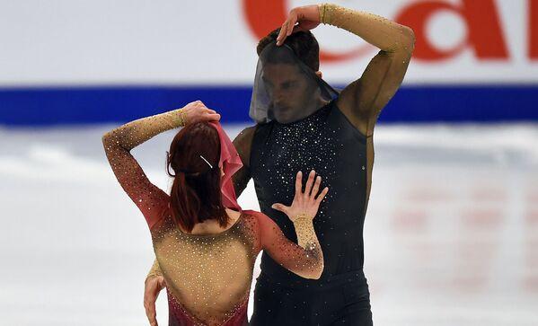 Итальянские спортсмены Николь Делла Моника и Маттео Гуаризе на чемпионате мира по фигурному катанию в Стокгольме - Sputnik Таджикистан