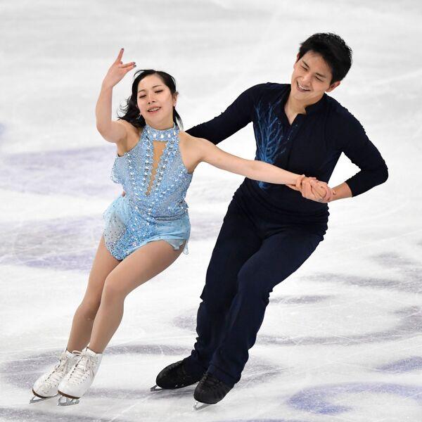 Японские фигуристы Рику Миура и Рюити Кихара выступают с короткой программой. В сумме они набрали 184,41 балла. - Sputnik Таджикистан