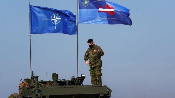 Военные учения боевой группы передового присутствия НАТО Хрустальная стрела-2021 в Адажи - Sputnik Таджикистан