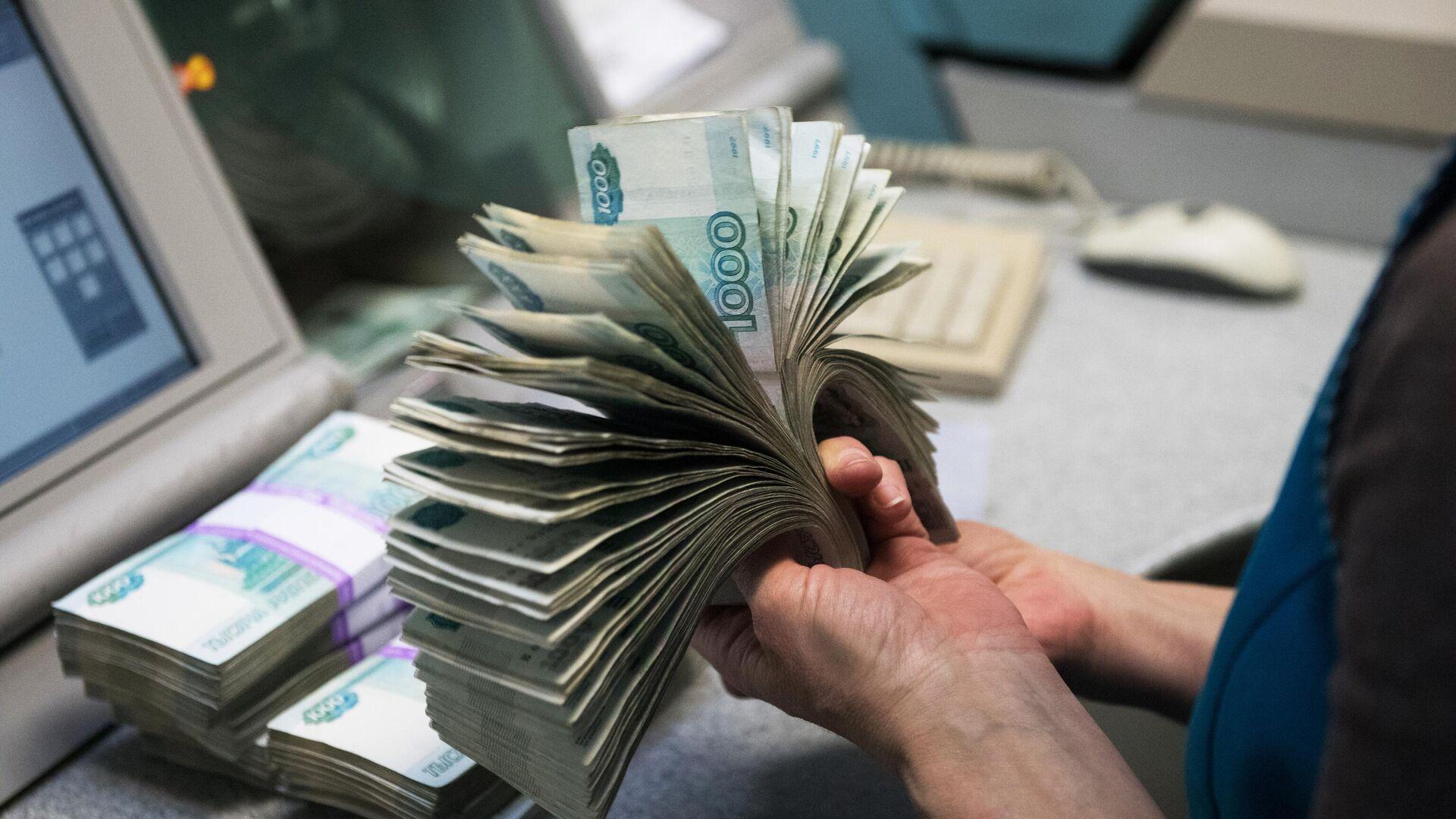 Банкноты номиналом 1000 рублей - Sputnik Тоҷикистон, 1920, 14.08.2021