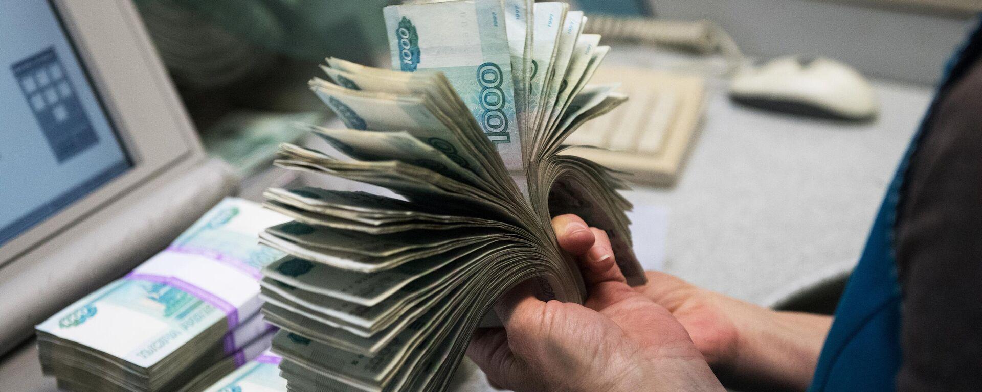 Банкноты номиналом 1000 рублей - Sputnik Таджикистан, 1920, 17.05.2021