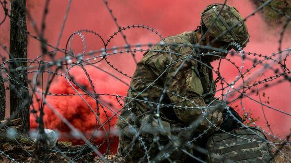 Военный США на учениях, архивное фото - Sputnik Таджикистан