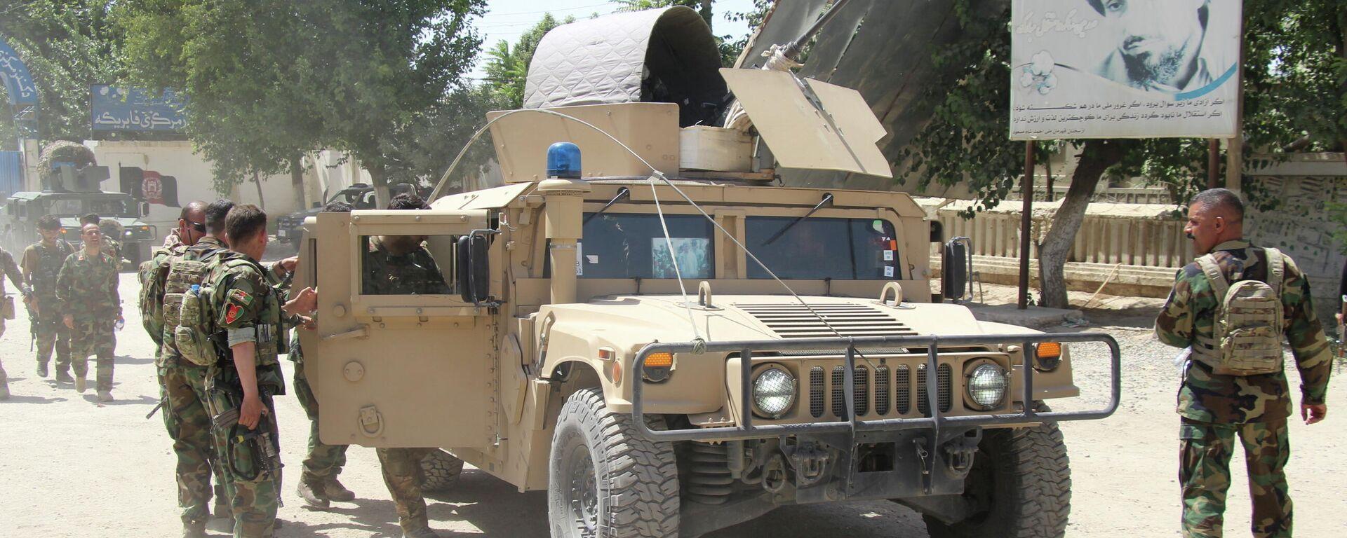 Военные Афганистана на месте боестолкновения с боевиками Талибана в провинции Кундуз, Афганистан 22 июня 2021 - Sputnik Таджикистан, 1920, 04.07.2021