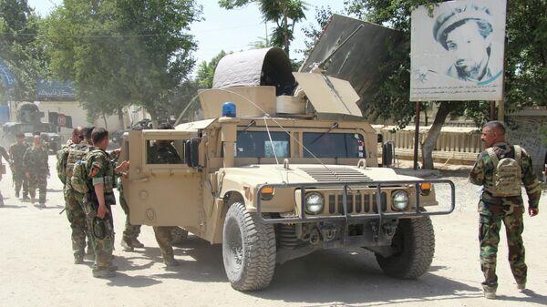Военные Афганистана на месте боестолкновения с боевиками Талибана в провинции Кундуз, Афганистан 22 июня 2021 - Sputnik Тоҷикистон