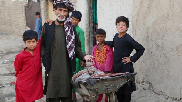Беженцы из зоны боевых действий в Афганистане - Sputnik Тоҷикистон