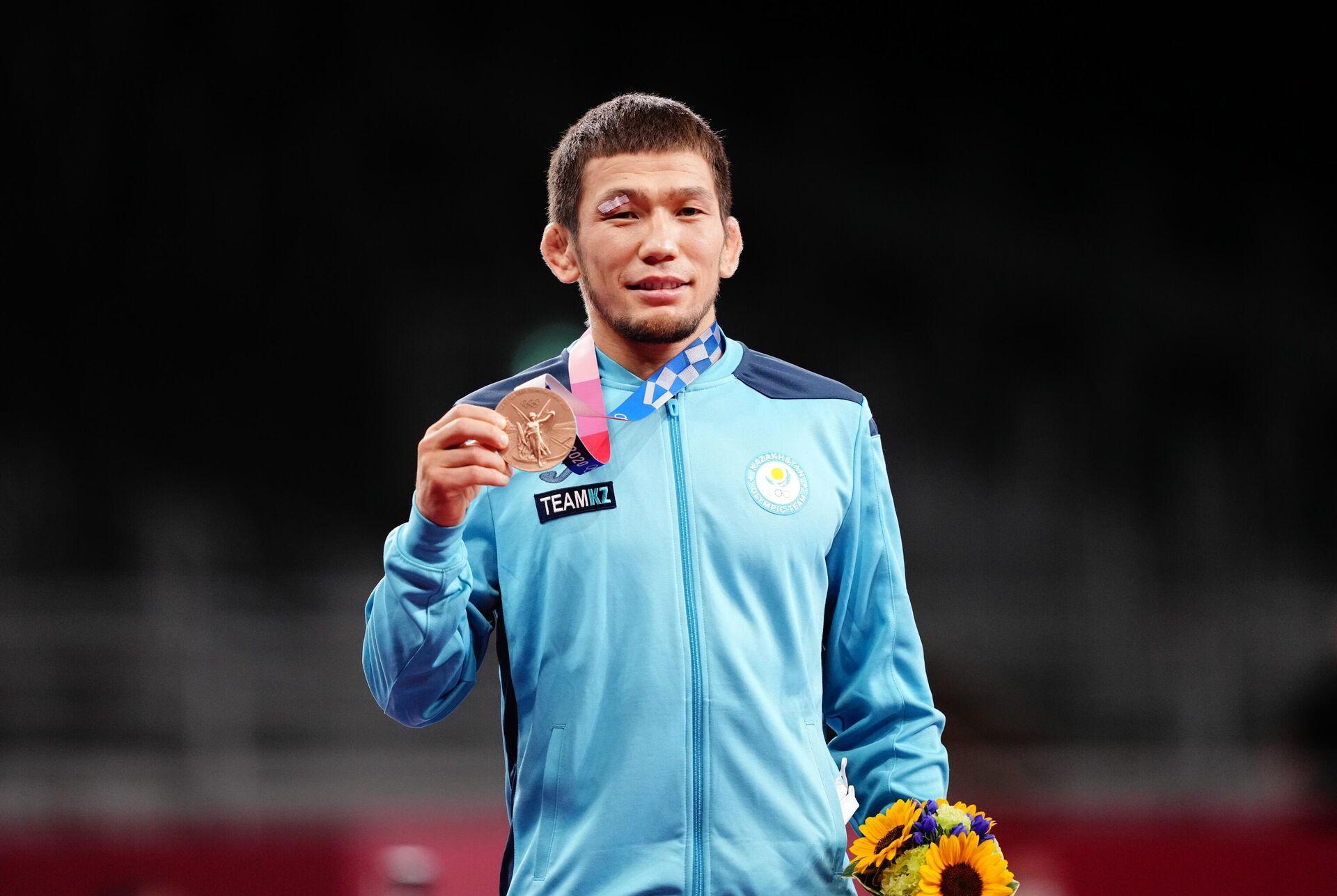 Нурислам Санаев (Казахстан), завоевавший бронзовую медаль в соревнованиях по вольной борьбе среди мужчин - Sputnik Таджикистан, 1920, 09.08.2021