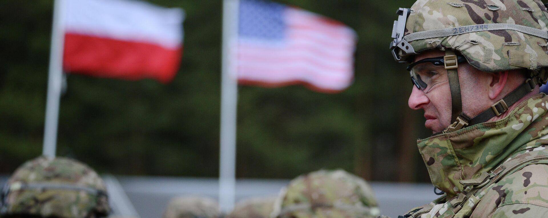 Церемония приветствия многонационального батальона НАТО под руководством США в польском Ожише - Sputnik Тоҷикистон, 1920, 12.08.2021