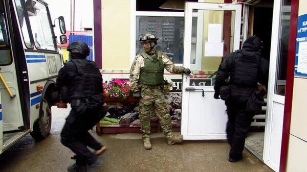 Задержание террористов ячейки Катиба Таухид валь-Джихад*. Кадры ФСБ - Sputnik Таджикистан