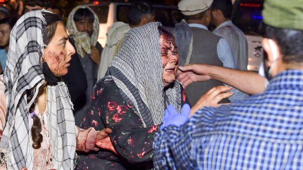 Женщины, раненые в результате двух мощных взрывов, произошедших в Кабуле - Sputnik Таджикистан