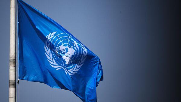 Флаг ООН - Sputnik Тоҷикистон