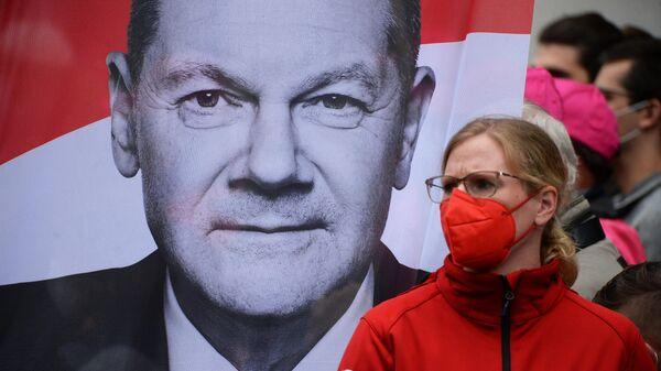 Предвыборные митинги кандидата в канцлеры ФРГ от партии SPD О. Шольца - Sputnik Таджикистан