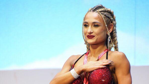 Эвелина Юсупова заняла первое место на XII чемпионате мира по бодибилдингу в Ташкенте - Sputnik Таджикистан