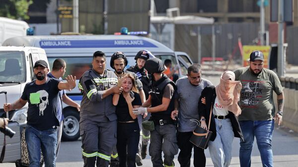 Пострадавшие во время стрельбы в Бейруте - Sputnik Таджикистан