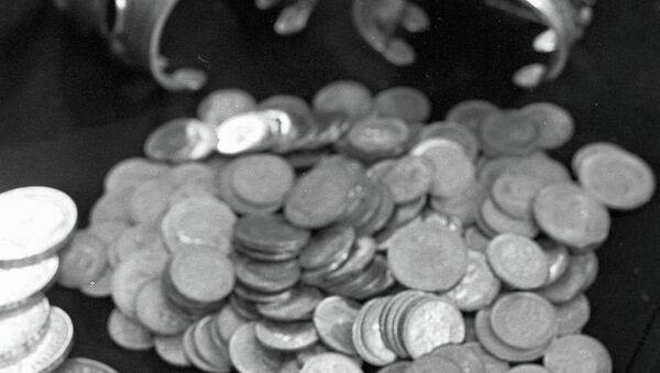 Золотые монеты. Архивное фото - Sputnik Таджикистан