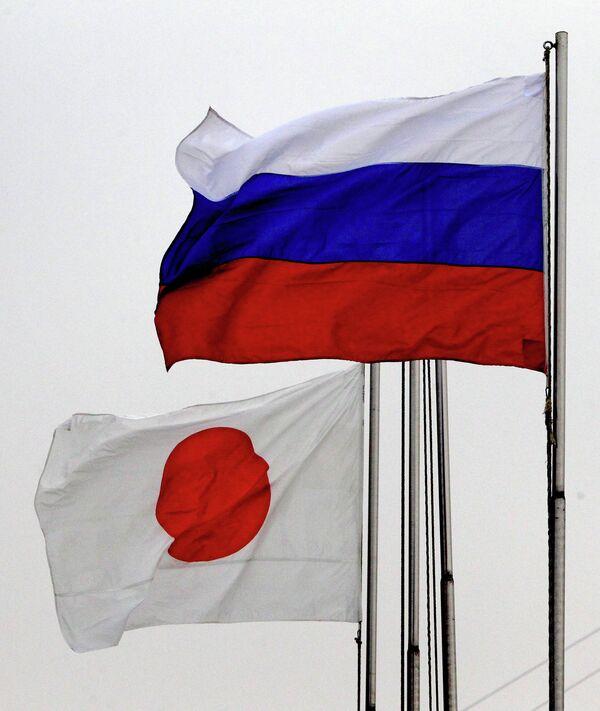 Флаги Японии и России. Архивное фото - Sputnik Таджикистан