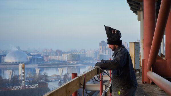 Мигранты на строительном объекте. Архивное фото - Sputnik Таджикистан