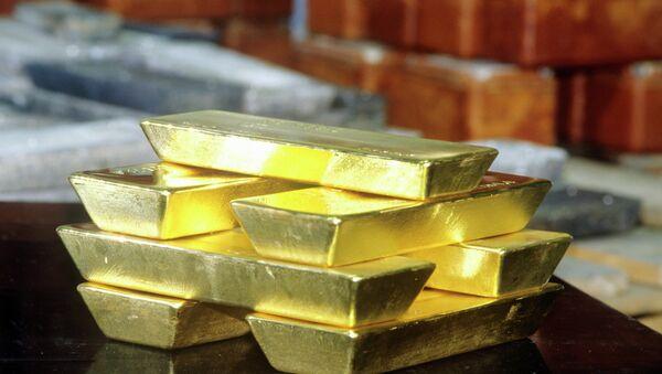Слитки золота. Архивное фото - Sputnik Таджикистан