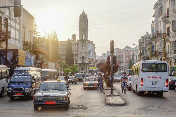 Автомобильное движение на одной из улиц Триполи. Архивное фото - Sputnik Таджикистан