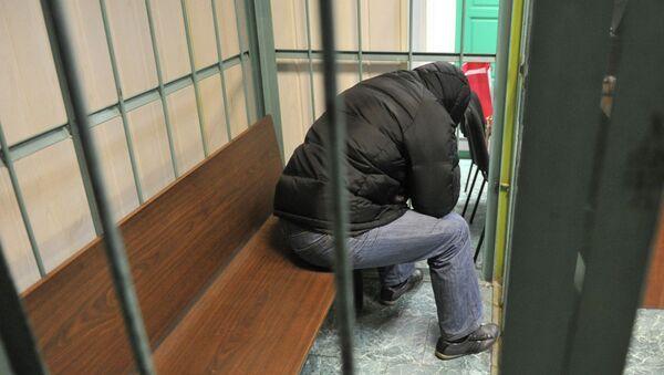 Обвиняемый в за решеткой. Архивное фото - Sputnik Таджикистан