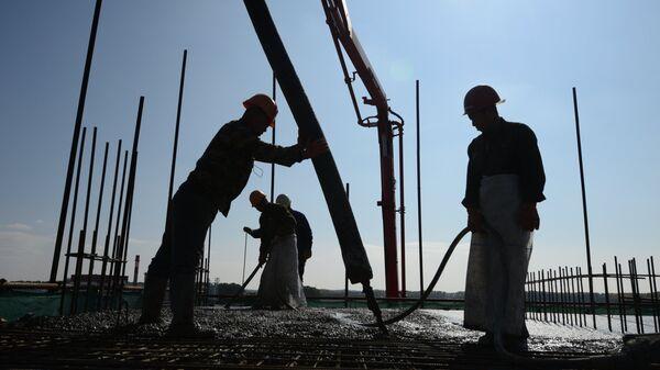 Мигранты работающие на стройках. Архивное фото - Sputnik Тоҷикистон