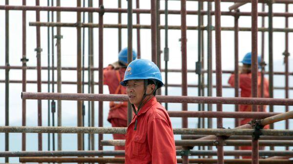 Китайский рабочий. Архивное фото - Sputnik Таджикистан