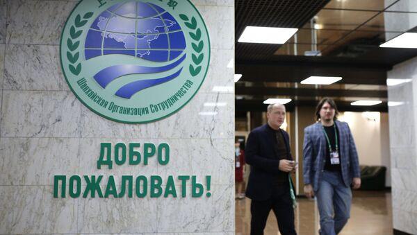 Логотип Шанхайской организации сотрудничества (ШОС). Архивное фото - Sputnik Таджикистан