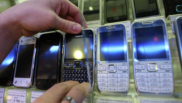 Витрина с сотовыми телефонами. Архивное фото - Sputnik Таджикистан