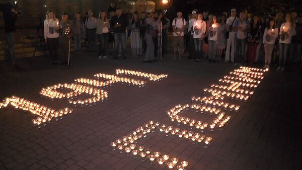 День памяти и скорби: огни над Москвой-рекой, свечи в Крыму и салют в Донецке - Sputnik Таджикистан