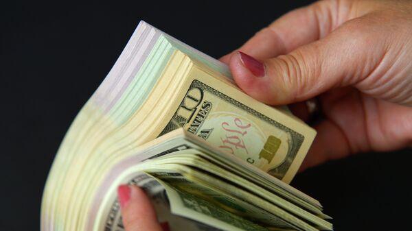 Доллары, архивное фото. - Sputnik Таджикистан