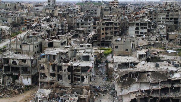 Разрушенные дома в результате боевых действий дома в Хомсе, Сирия. Архивное фото. - Sputnik Таджикистан