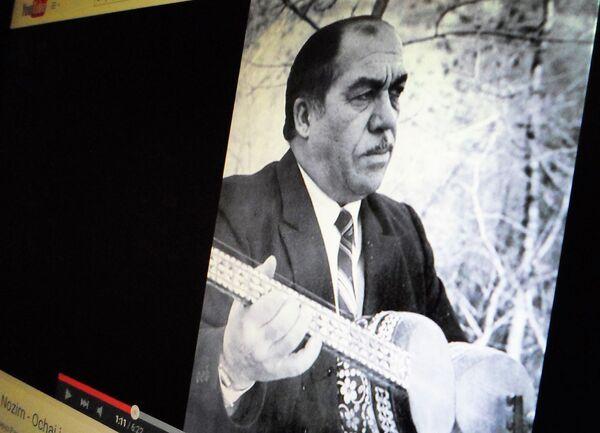 Фотография Зафара Нозима в видеоролике YouTube. Снимок с экрана - Sputnik Таджикистан