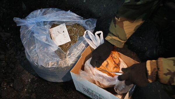 Уничтожение крупной партии наркотиков, архивное фото - Sputnik Тоҷикистон