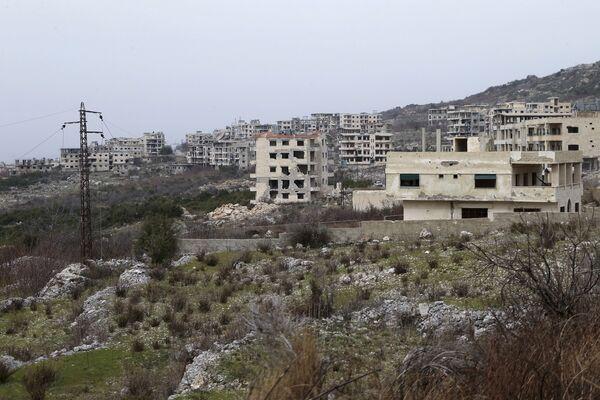 Полуразрушенные дома в провинции Латакия (Сирия). Архивное фото - Sputnik Таджикистан