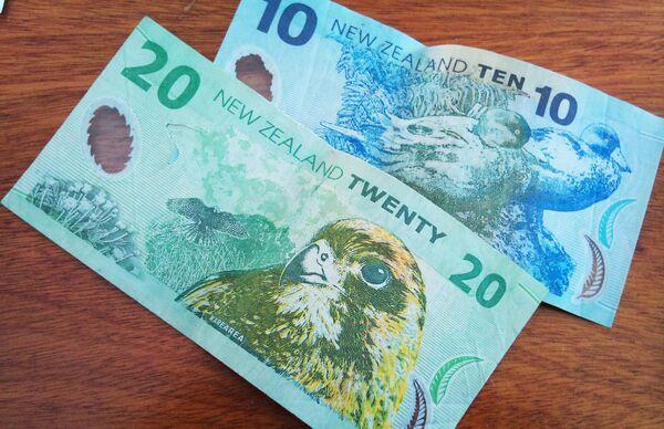 Новозеландский доллар. Архивное фото - Sputnik Таджикистан