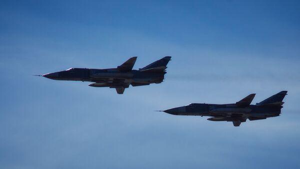 Фронтовые бомбардировщики Су-24М. Архивное фото - Sputnik Таджикистан