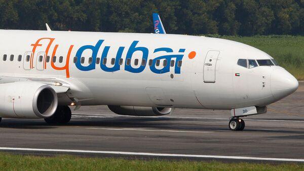 Ҳавопаймои Boeing 737-800-и ширкати Fly Dubai. Акс аз бойгонӣ - Sputnik Тоҷикистон