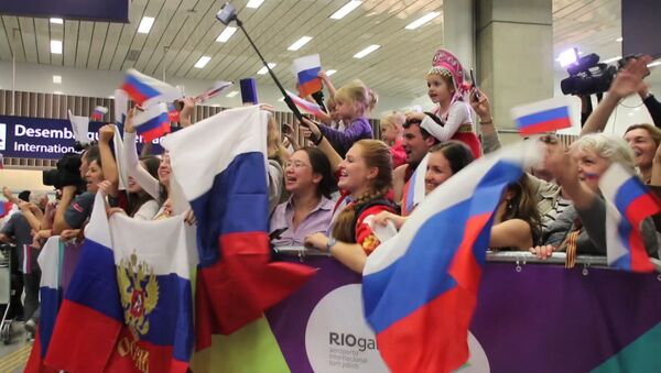 Болельщики спели Катюшу российским олимпийцам в аэропорту Рио-де-Жанейро - Sputnik Таджикистан