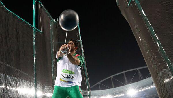 Дильшод Назаров во время метания молота в финале турнира на ОИ в Рио-де-Жанейро - Sputnik Таджикистан