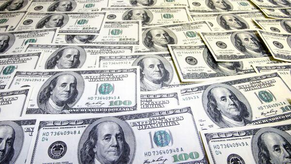 Доллары США, архивное фото - Sputnik Тоҷикистон