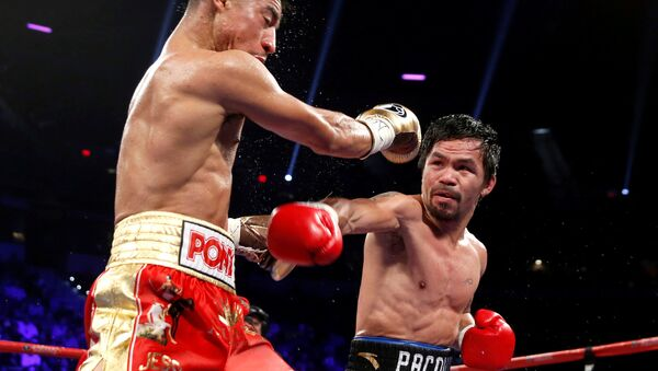 Поединок филиппинского боксера Мэнни Пакьяо и американца Джесси Варгаса - Sputnik Таджикистан