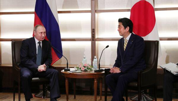 Официальный визит президента РФ В. Путина в Японию - Sputnik Таджикистан